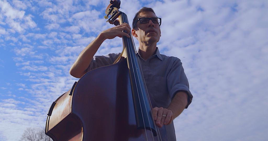 Greeg Loughman playing bass fiddle.